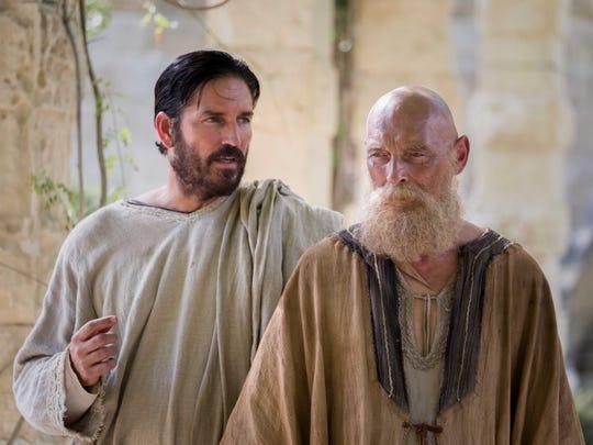 "Luke (Jim Caviezel) and Paul (James Faulkner) confer in ""Paul, Apostle of Christ."""