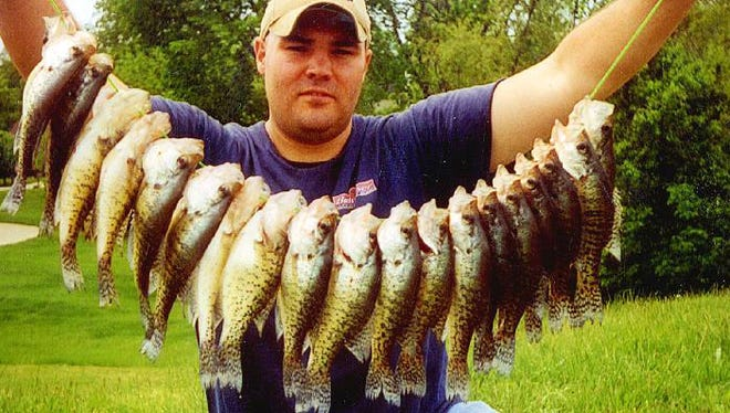 Guide Colby Simms with a stringer of crappies caught drifting.