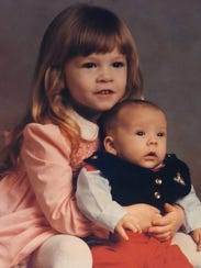 A young Heather Jones poses with her brother, Jeff