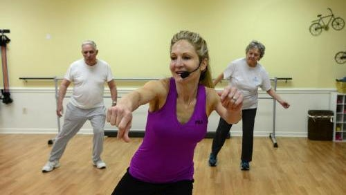 GroupHab owner Patrice Hazan leads a workout at her Simpsonville facility.
