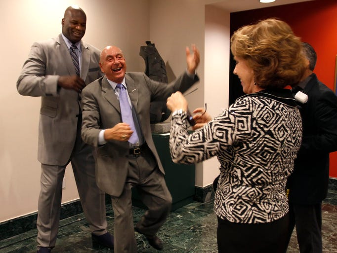 Lorraine Vitale takes a phone picture of husband, ESPN college basketball analyst Dick Vitale, as he pretends to guard retired NBA superstar Shaquille O'Neal at the  Boys & Girls Club of Collier County's Youth of the Year Celebration at Artis-Naples Monday.
