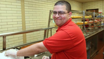 Justin Morales of New City works in the cafeteria at North Rockland High School in Theills on June 11. ARC of Rockland placed him in the job.