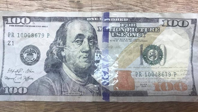 In this June 2017 file photo, a fake $100 bill was used at the Old Spanish Bridge Market in Agat in June, according to the store owner Joey Charfauros. Another report of a fake $100 bill used in Asan was reported by police.