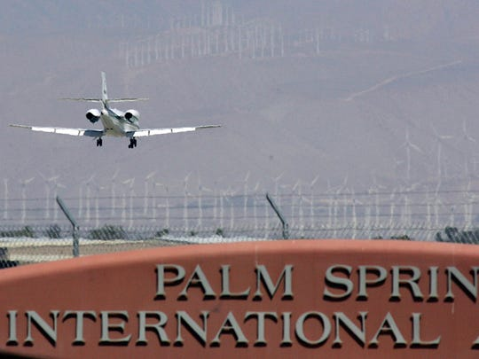 A passenger jet lands at Palm Springs International Airport in this 2012 file photo.