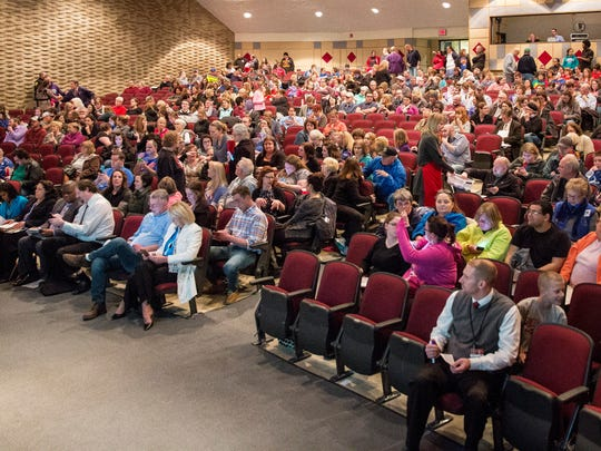 A large crowd attends the Muncie Community School Board
