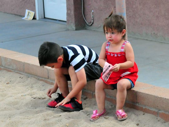 Christian Perea, 5, and Dariana Pina 2 get ready to play in the large sand box in an area just for children.  The photo was taken June 4, 2016.