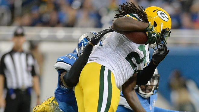 Green Bay Packers running back Eddie Lacy (27) leaps defender Darius Slay (23) during a run against the Detroit Lions at Ford Field in Detroit on Sunday.