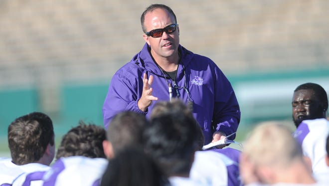 First-year ACU coach Adam Dorrel talks to his team before the annual Purple & White Game on Friday, April 7, 2017 at Shotwell Stadium.