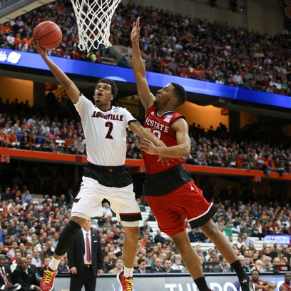 U of L's Quentin Snider, #2, beats NC State's Ralston