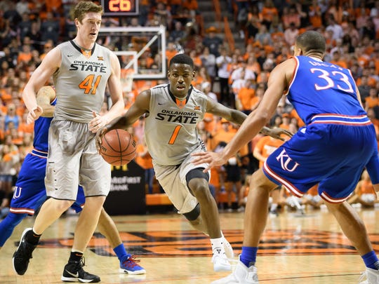 Oklahoma State guard Jawun Evans, middle, could lead