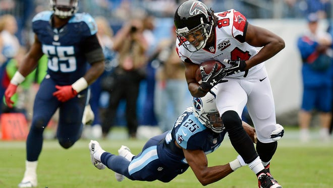 Tennessee Titans cornerback Blidi Wreh-Wilson (25) dives to stop Atlanta Falcons wide receiver Roddy White (84) in the first half.