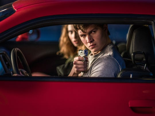 "Baby (Ansel Elgort) and Debora (Lily James) jack a car to get away in ""Baby Driver."""