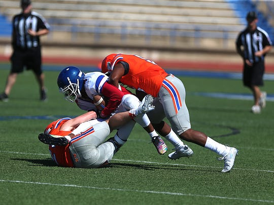 Central's Daylon Green (#5) comes from behind to help his teammate tackle a player from Abilene's Cooper High School during a game of scrimmage at San Angelo Stadium Friday, August 24, 2018.