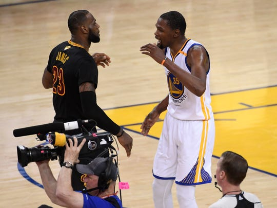 Golden State Warriors forward Kevin Durant (35) hugs Cleveland Cavaliers forward LeBron James (23) after game five of the 2017 NBA Finals at Oracle Arena.