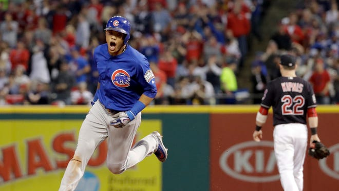 The Chicago Cubs' Addison Russell celebrates after his grand slam against the Cleveland Indians during the third inning of Game 6 of the World Series on Tuesday in Cleveland.