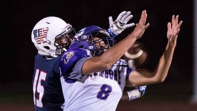 Lemoore's Sean Patrick intercepts a pass intended for Tulare Western's Mark Smith in a non-league high school football game on Thursday, August 30, 2018.