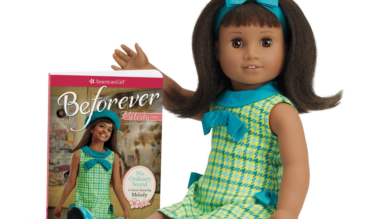"""Jaelyn Kangas, 4, Scottsdale, fixes the hair of her American Girl doll, """"Charlotte."""""""