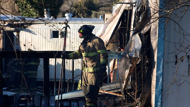 Firefighters put a fire under control after it burned several mobile homes in a vacated section of Glasgow Court trailer park Tuesday. The fire, reported about 5 p.m., damaged or destroyed 9 trailer homes.