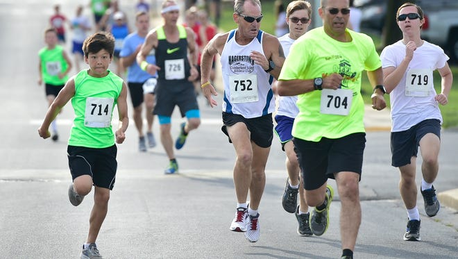 Runners take part in the 14th Annual Tim & Susan Cook Memorial ChambersFest 1-Mile Race/Walk that took place last July