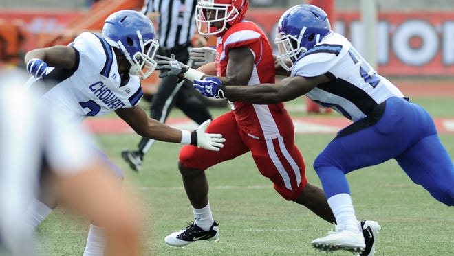 A Delaware State running back runs with the ball in their 30-31 loss against Chowan College in 2015.