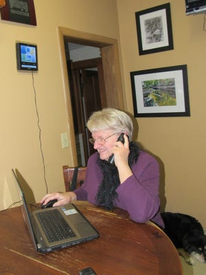 Susan on the phone with her friend Joyce as they chat and play WORDS with Friends across the miles.