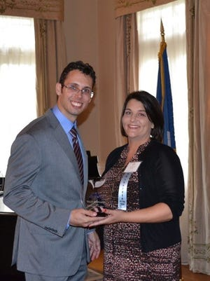 Tally Bernard was one of A+PEL's Volunteers of the Year. She is pictured with A+PEL Executive Director Keith Courville.
