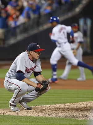 Minnesota Twins relief pitcher Ryan O'Rourke reacts after giving up the game-winning home run to the New York Mets' Curtis Granderson (3) during the twelfth inning Saturday in New York. The Mets won 3-2.