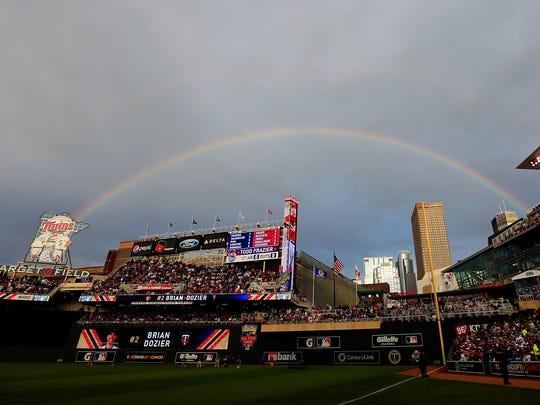 A rainbow frames Target Field on Monday night.