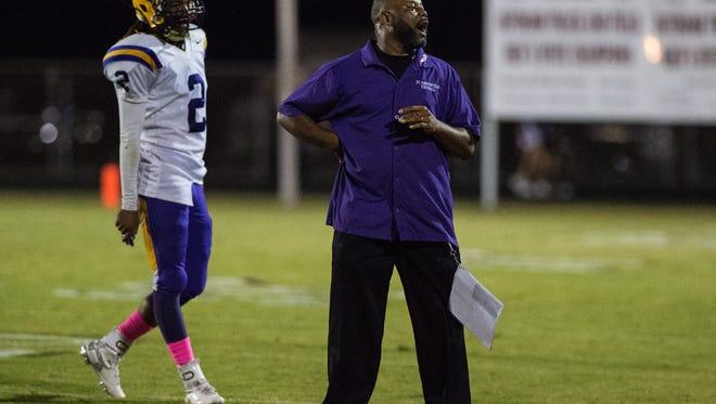 St. Martinville head coach Vincent Derouen walks on field during the first half of an LHSAA football game at Breaux Bridge High School in Breaux Bridge, La., Thursday, Oct. 8, 2015.