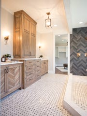 Extensive custom tilework can be found throughout the home.