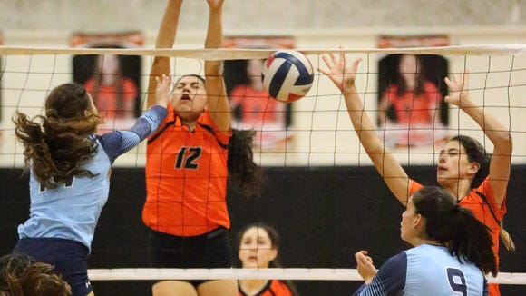 Jalile Rodriguez, 12, of El Paso High blocks a shot from Chapin's Abigail Porras left, earlier this season.