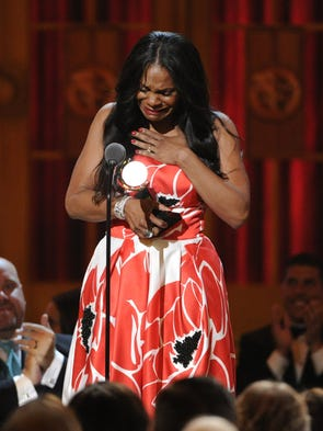 "Audra McDonald, a Croton-on-Hudson resident, accepts the award for best performance by an actress in a leading role in a play for ""Lady Day at Emerson's Bar & Grill"" on stage at the 68th annual Tony Awards at Radio City Music Hall on Sunday, June 8, 2014, in New York. (Photo by Evan Agostini/Invision/AP)"