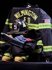 Turnout gear representing Wilmington firefighter Ardythe Hope is arranged at her memorial service at the Chase Center on the Riverfront in Wilmington on Dec. 10.