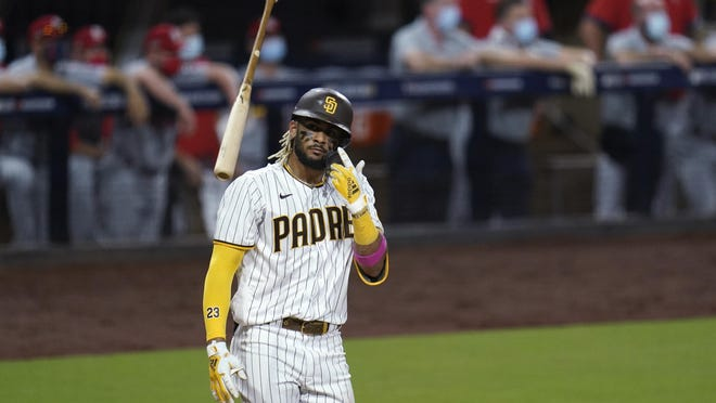 San Diego Padres' Fernando Tatis Jr. tosses his bat after hitting a two-run home run during the seventh inning of Game 2 of a National League Wild Card series against the St. Louis Cardinals on Thursday in San Diego.