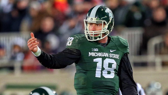 Michigan State Spartans quarterback Connor Cook (18) gestures to sidelines during the 2nd half of a game against Ohio State at Spartan Stadium.