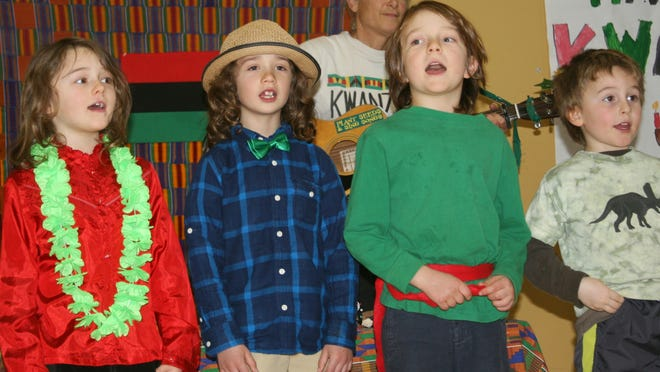 """Quincy Sabick of Ferrisburgh, Dominic Petrarca of Burlington, Henry Dorman of South Burlington and Isaac Helak of Shelburne sing """"Michael Row the Boat Ashore"""" as part of the Kwanzaa celebration at The Schoolhouse in South Burlington."""