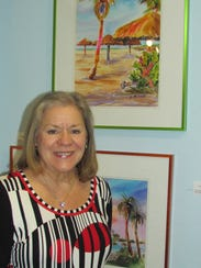 Judy Chinski next to her artwork.