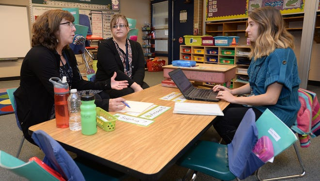 Donna Boudreau, from left, Wini Hunt and Alex Devalk follow up after an Individualized Education Plan (IEP) meeting at Bennett Elementary School in Fort Collins on Tuesday, Dec. 20, 2016. If PSD chooses to accept Medicaid reimbursements, the district would be at least partially reimbursed for services provided to Medicaid-eligible students on IEPs.