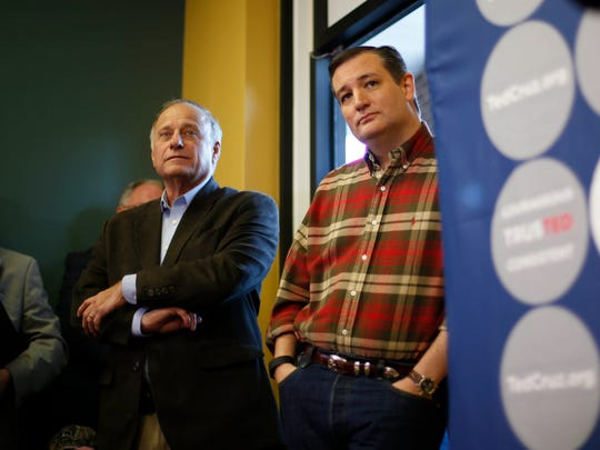 U.S. Sen. Ted Cruz, right, waits alongside Iowa congressman Steve King before being introduced to supporters at the Crossroads Shooting Sports gun shop on Friday, Dec. 4, 2015, in Johnston, Iowa.