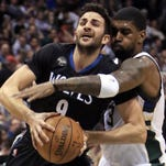 Bucks guard O.J. Mayo (right) fouls Timberwolves guard Ricky Rubio Friday.