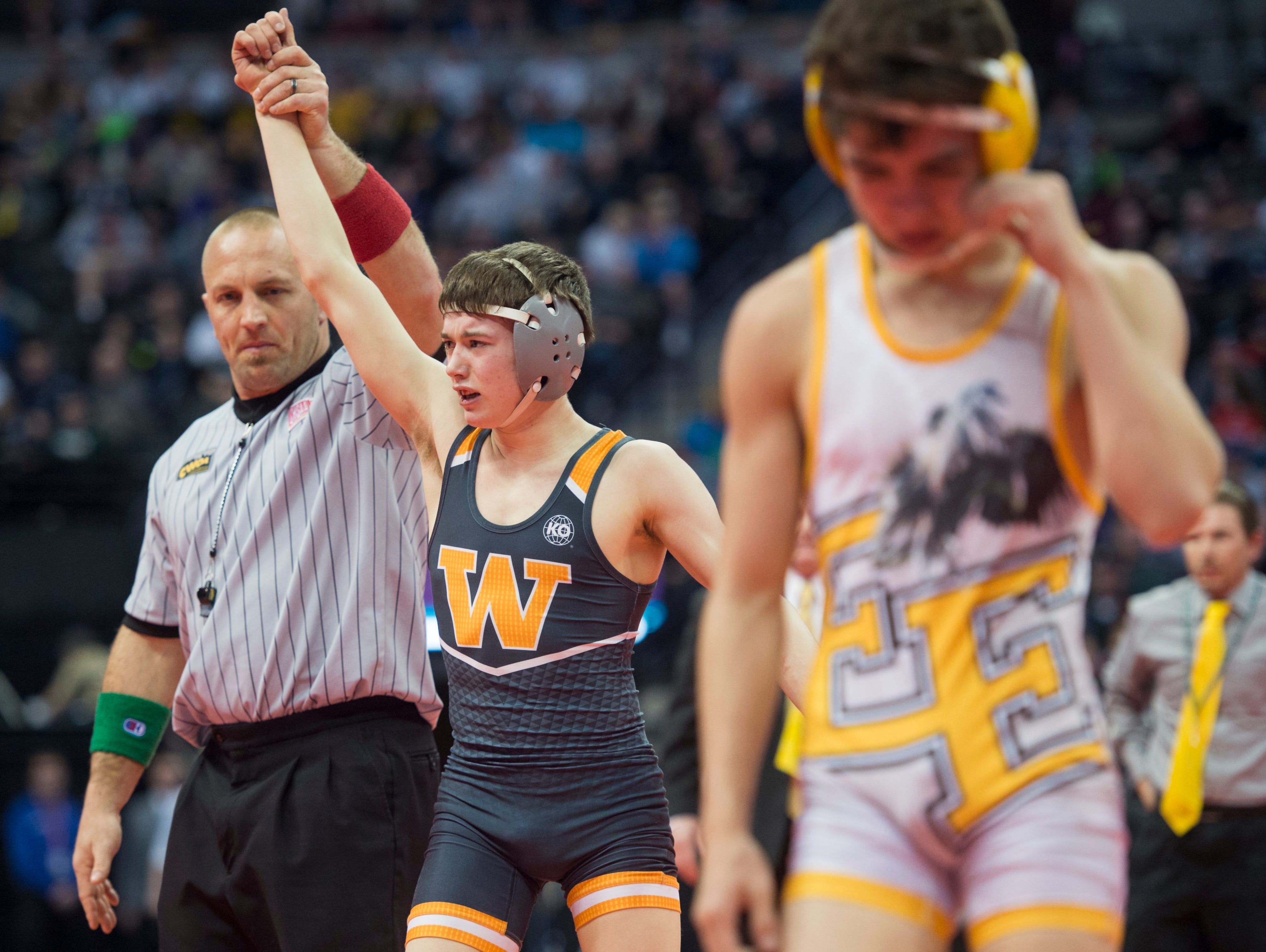 Will Vombaur of Windsor High School is declared champion following his first place match against Andrew Lucero of Pueblo East during the CHSAA state wrestling tournament at the Pepsi Center in Denver Saturday, February 20, 2016. Greenwood walked away with his second state title.