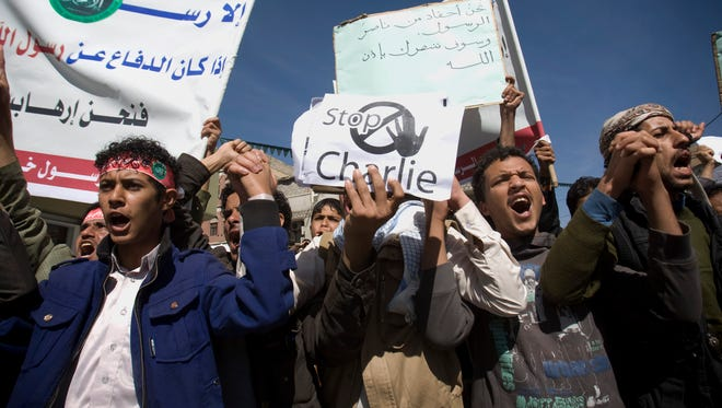 Yemenis chant slogans during a protest against caricatures published in French magazine Charlie Hebdo in front of the French Embassy in Sanaa, Yemen, Saturday.