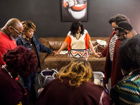 Members of the Orange Mound Council pray at the conclusion of one of their meetings Jan. 24, 2018.