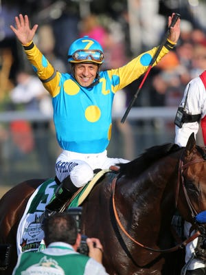 Victor Espinoza celebrates aboard American Pharoah after winning the Belmont Stakes and the Triple Crown.June 6, 2015