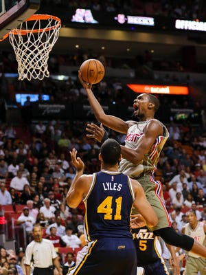 Miami Heat forward Chris Bosh drives to the as Utah Jazz forward Trey Lyles defends during the first half at American Airlines Arena.