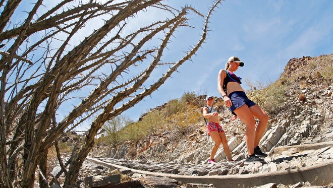 Emily Crafton (right) and Kimberly Ander hike down the summit trail on Piestewa Peak on Wednesday, May 31, 2017 in Phoenix, Ariz.