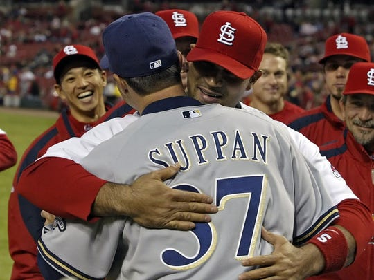 Jeff Suppan gets a hug from his former teammate Albert