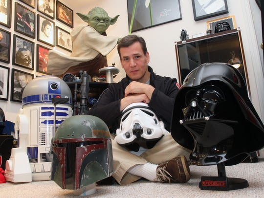 Bob DeSimone, a star wars fan is photographed with some of his Star Wars collectibles at his Peekskill home Dec. 9, 2015. DeSimone is a member of the 501st Legion, a group of volunteers who create screen-accurate Star Wars costumes to appear at places like children's hospitals.