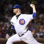 Jon Lester pitches in the ninth inning at Wrigley Field.
