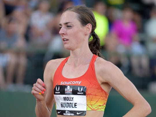 Molly Huddle wins the women's 10,000 meters at the